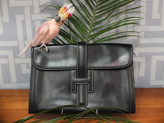 Pochette de jour Hermès modèle Jigé en cuir noir