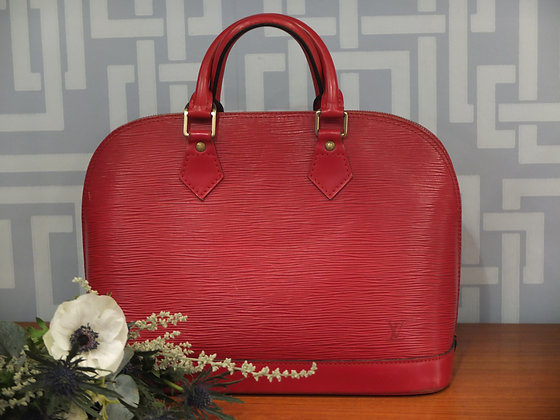 Sac à main Louis Vuitton modèle Alma rouge