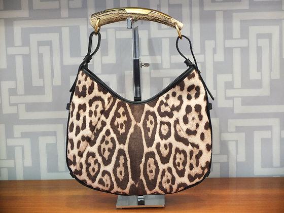 Sac à main Saint Laurent modèle Mombasa motif léopard et cuir noir