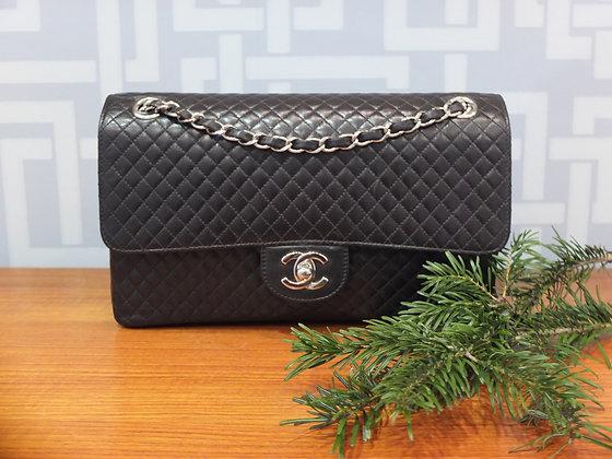 Sac à main Chanel - modèle classique en cuir mini matelassé noir
