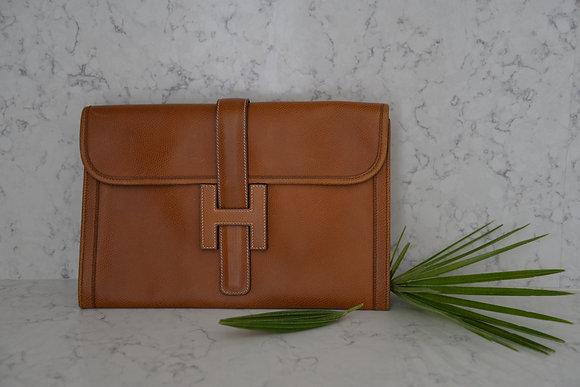 Pochette de jour Hermès modèle Jigé en cuir gold