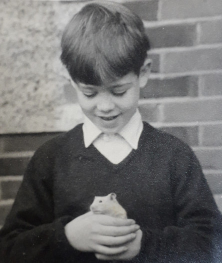 Hugh as a boy with pet rat