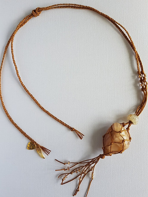 Gold macrame pendant with crystal