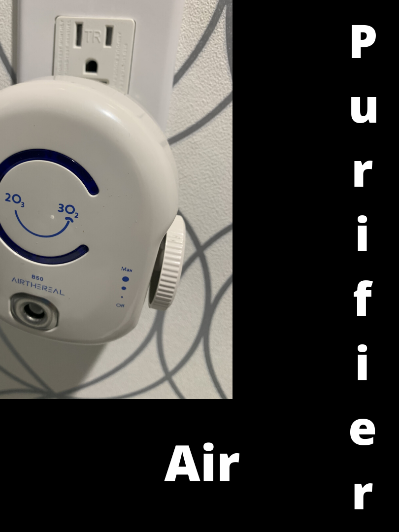air purifier in between patients.png
