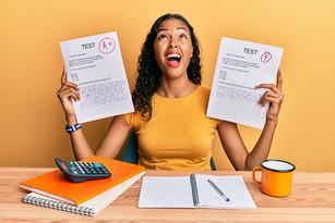 woman happy pass real estate exam