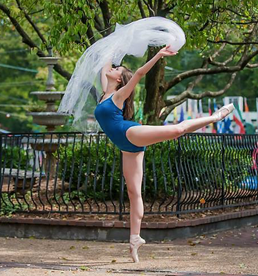 ballerina performing arabesque in park
