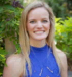 Dr Julie Granger in blue dress