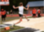 Highschool athlete in long jump competition