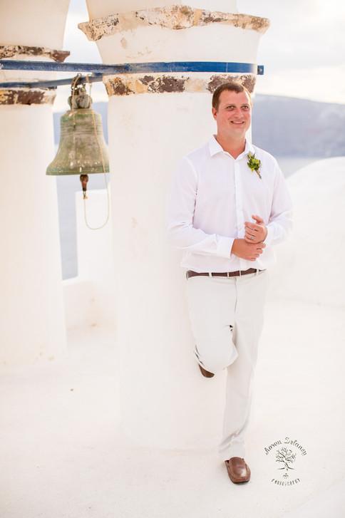 groom in Santorini Greece