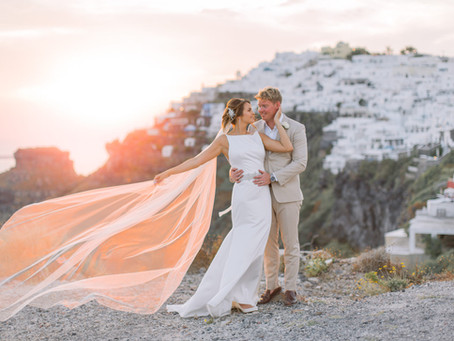 Cliff top destination wedding at Santo wines winery, Santorini Greece.