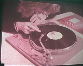 woman at turntable