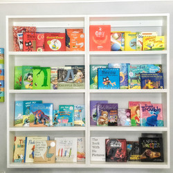 Organized Book Wall # rainbow