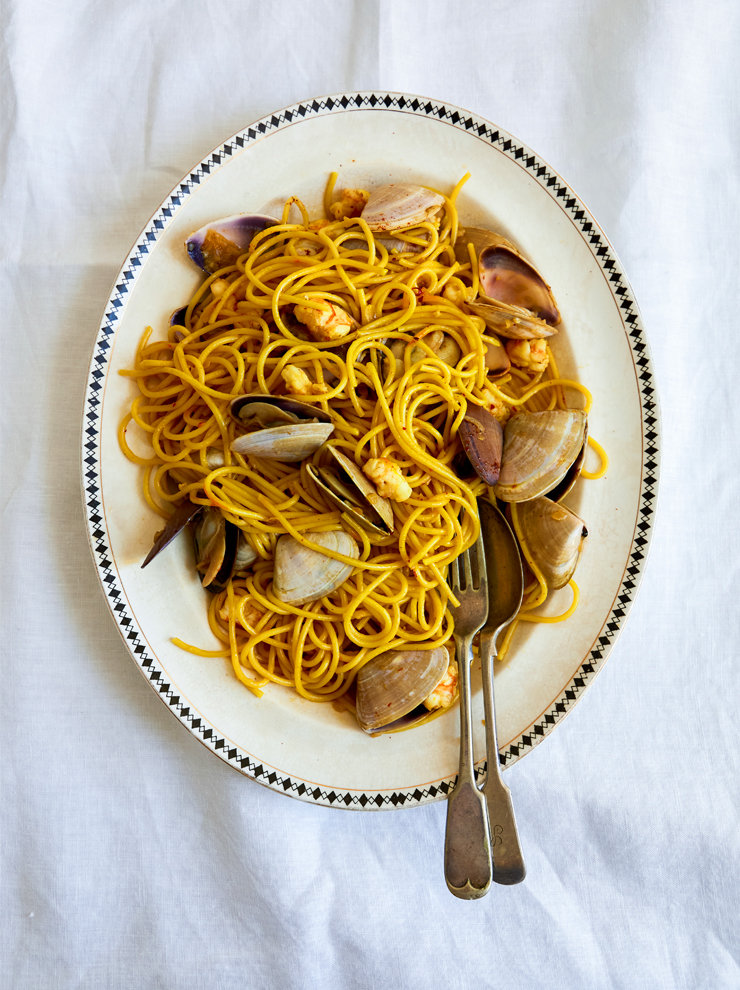 Pasta cooked in saffron stock with prawns and pipis