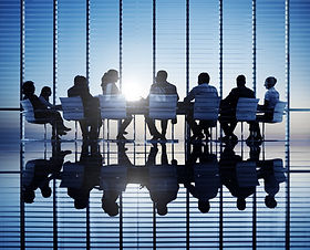 Silhouettes of business people in a conf