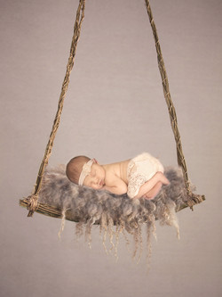 Newborn baby in swing