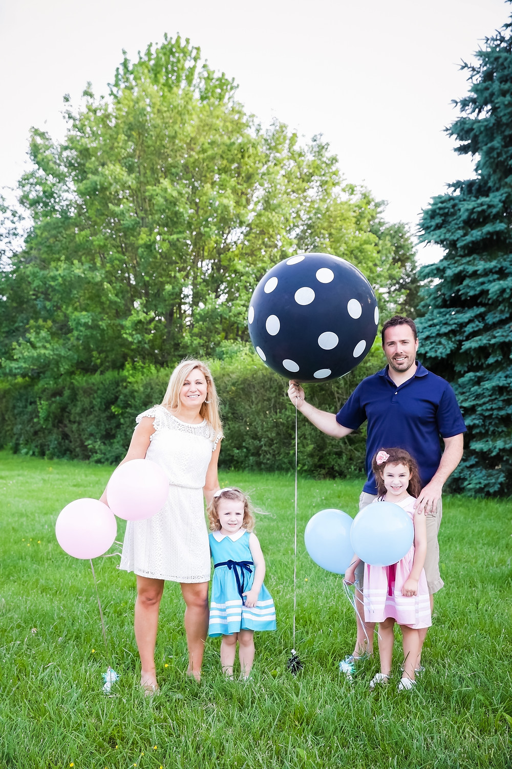 Gender Reveal with a balloon filled with confetti