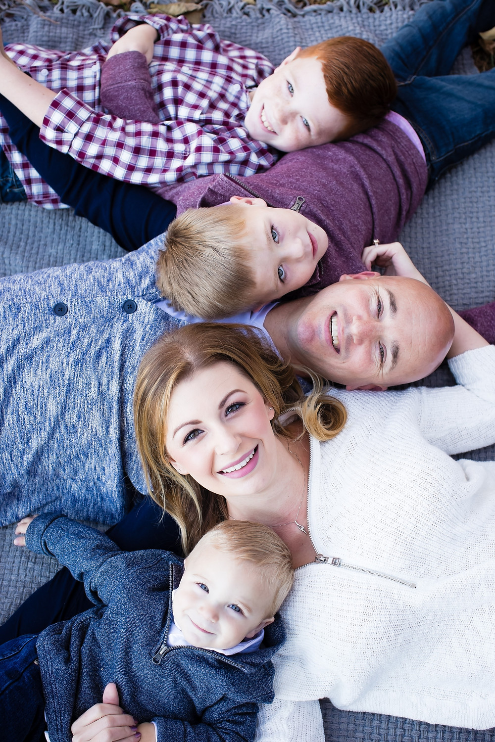 Pictures of a family that is coordinating the colors good for a family photo shoot by Kerry Paradis Photography