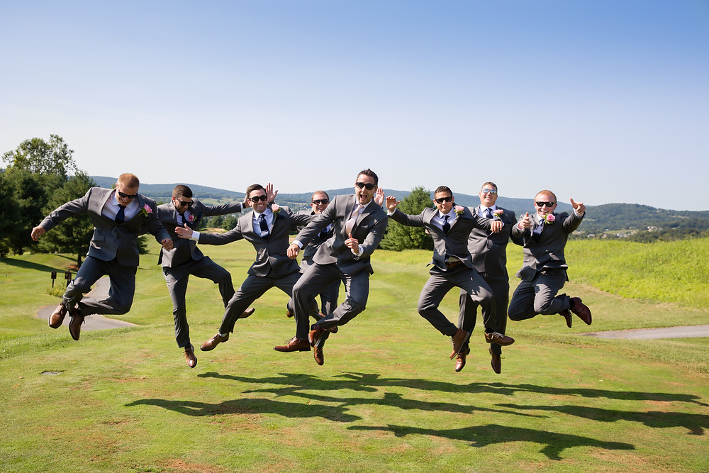 Picture of the groom and groomsman having some fun before the wedding.  It is very hard to get everyone to jump the same time!