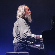 Lubomyr Melnyk is noted for his continuous music, a piano technique based on extremely rapid notes and complex note-series, usually with the sustain pedal held down to generate harmonic overtones and sympathetic resonances. These overtones blend or clash according to harmonic changes. Most of his music is for piano, but he has also composed chamber and orchestral works. His piano music requires a special technique, closely related to the Martial Arts, and is too complex and difficult for any concert pianists to play. Because of his lifelong devotion to the piano, he has been called The Prophet Of The Piano