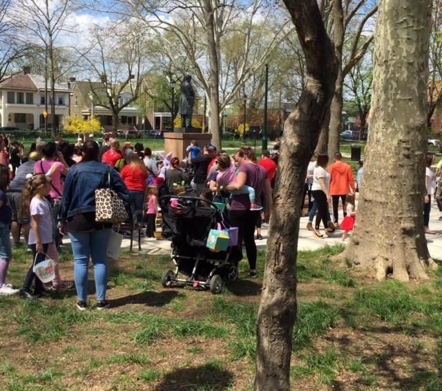 a crowd gathers around the bunny