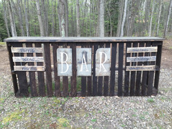 Bar made out of pallets for wedding reception.  Slate tiles hand painted withe B.A.R