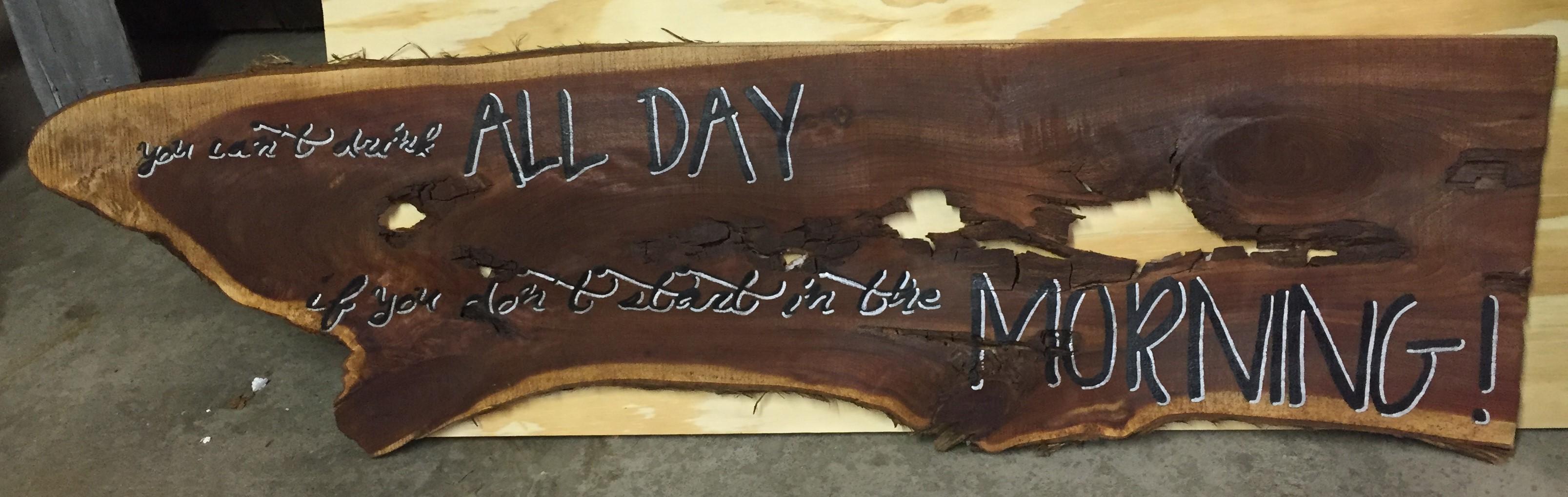 handpainted sign on redwood slab