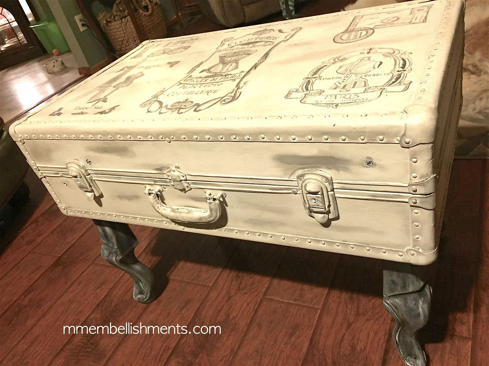 Vintage steamer trunk turned French motif coffee table