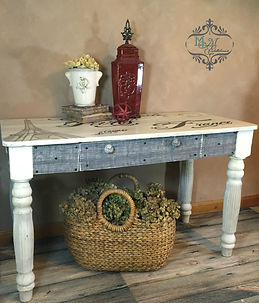 Farmhouse table wit French Artwork