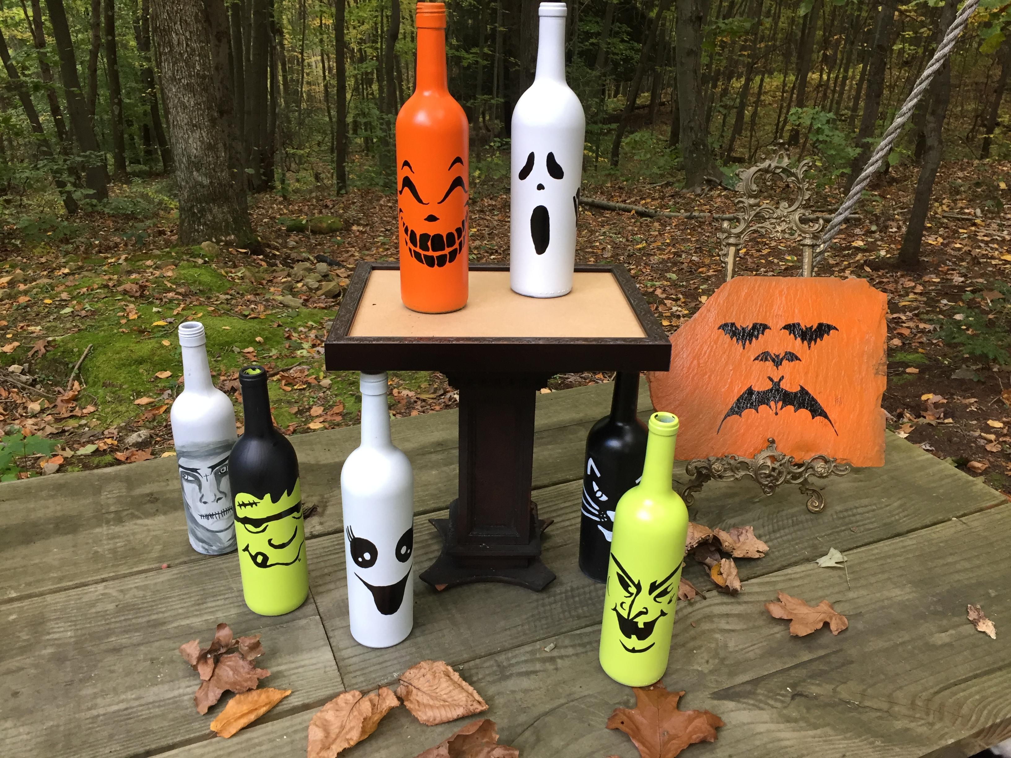 Halloween Decor on wine bottles and slate