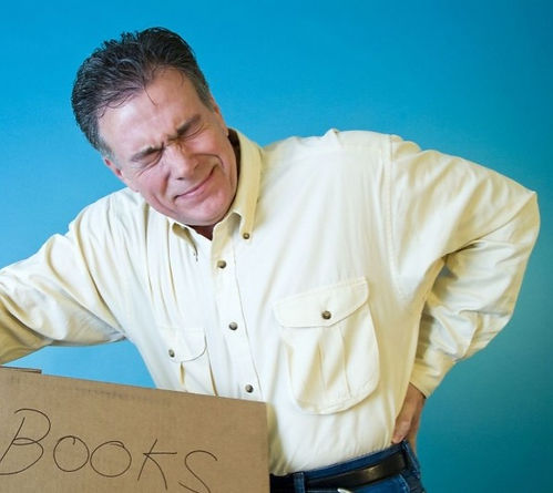 man_carrying box books_back pain_2533801