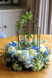 Blue floral birdcage centre piece