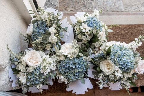 bridesmaid's blue bouquets
