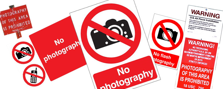 """A collection of """"no photography"""" warning signs"""