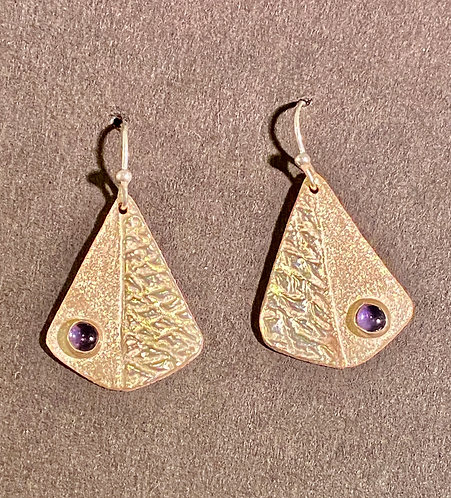 Fine and Sterling Silver Textured Earrings Set With Iolites