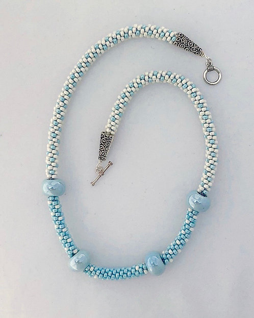 Kumihimo necklace with Mykonos Greek beads in blue and cream