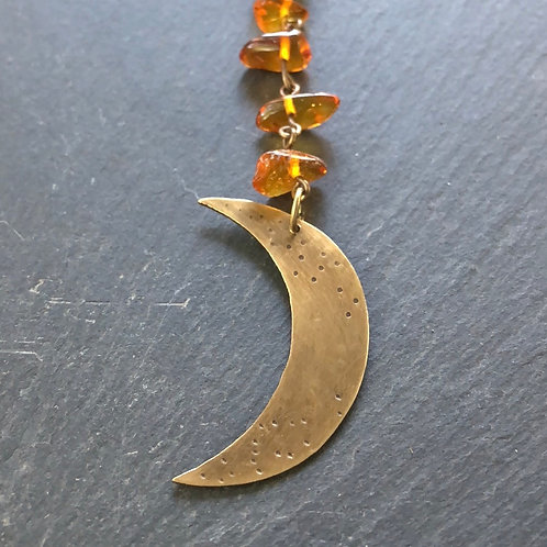 Bronze moon with Baltic amber