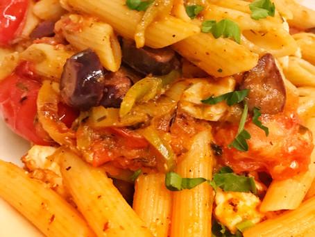 Pasta with sautéed Greek Salad ingredients