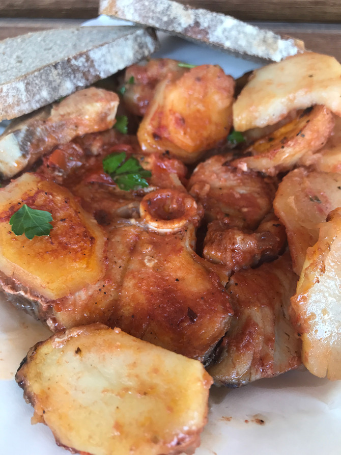 Fish (Plaki) in the oven with tomato and potatoes