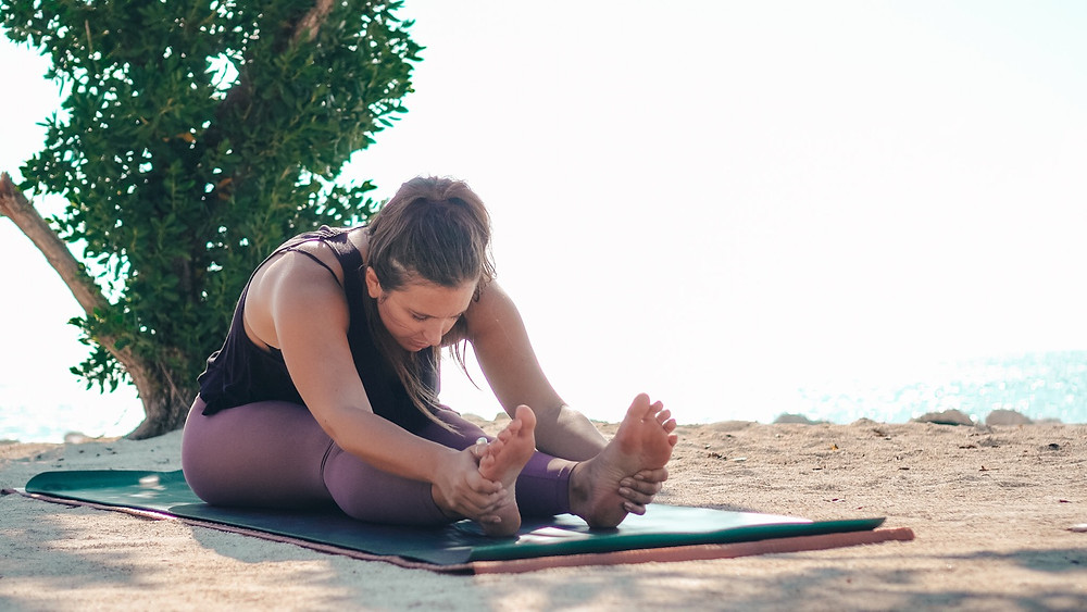 Bubbly Yogi Beach Yoga Florida Keys seated forward fold
