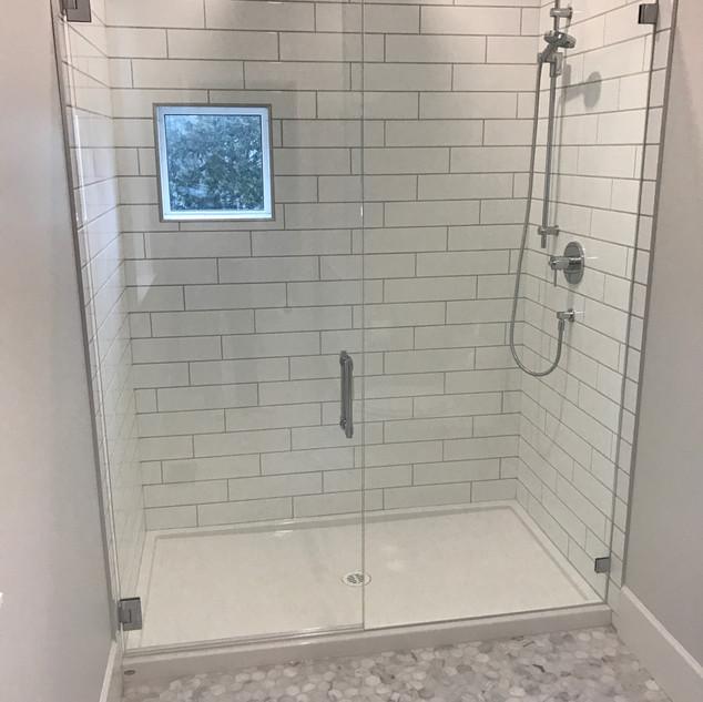 Frameless shower mirror