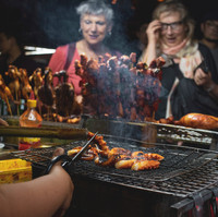 people-watching-barbecues-getting-cooked