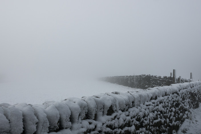 Snow, freezing fog ... and a wall