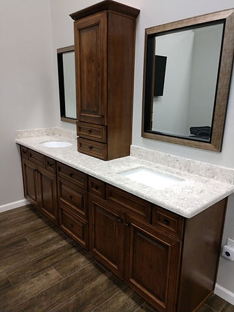Bathroom cabinet with a quartz countertop and undermount square sinks.