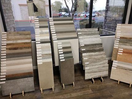 Porcelain tile sample racks in Avondale showroom. Stellar Kitchen and Bath