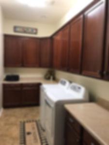 New uppers cabinets in a laundry room in Verado, Buckeye, Arizona