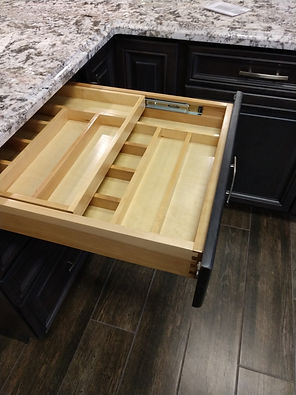 Two tier cutlery divider in kitchen cabinet