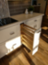 Pull out spice rack in base kitchen cabinet