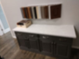 Sample cabinet doors and color chips wih quartz countertop.