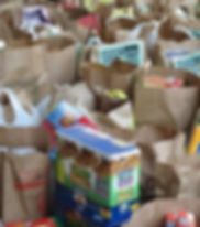 grocery bags filled with assorted foods