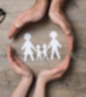 a paper cut out of a family holding hands in a circle of two peoples hands for the social service referrals button below